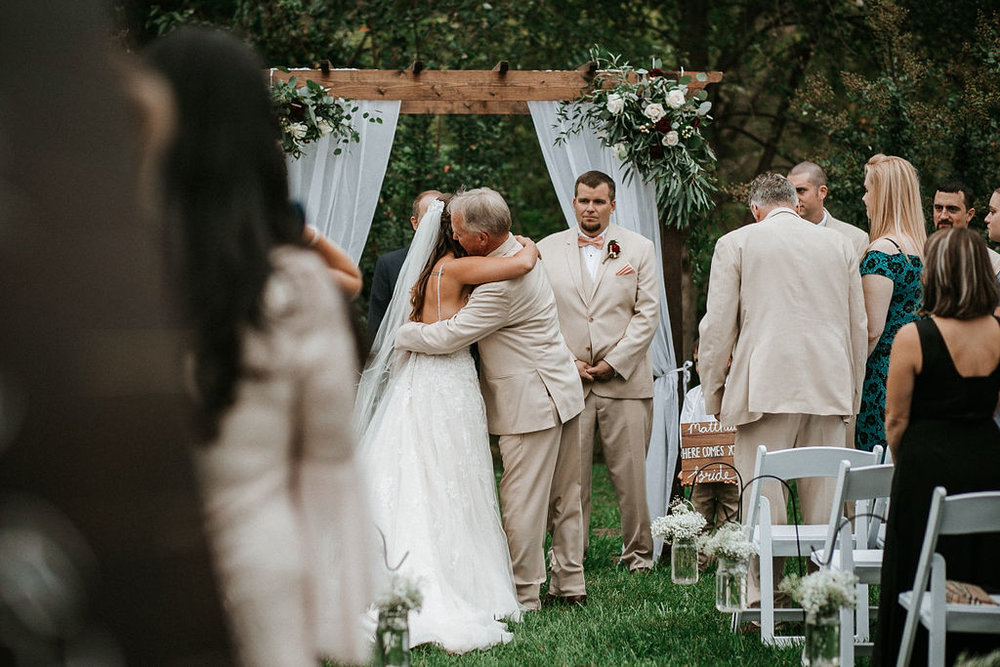 Father of the Bride giving bride away at the alter at 48 Fields Farm
