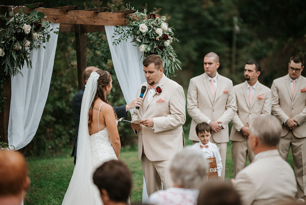 bride and groom holding hands at the alter at 48 Fields Farm