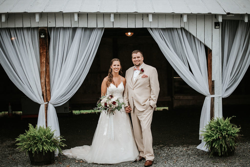 bride and groom smiling at 48 Fields Farm