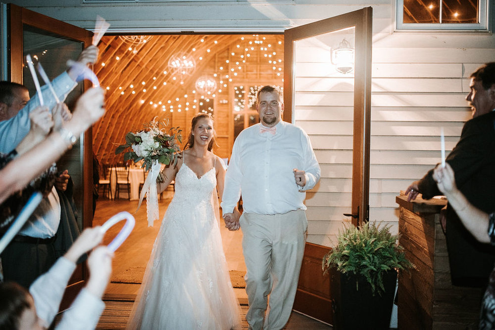 bride and groom leaving reception at 48 Fields Farm