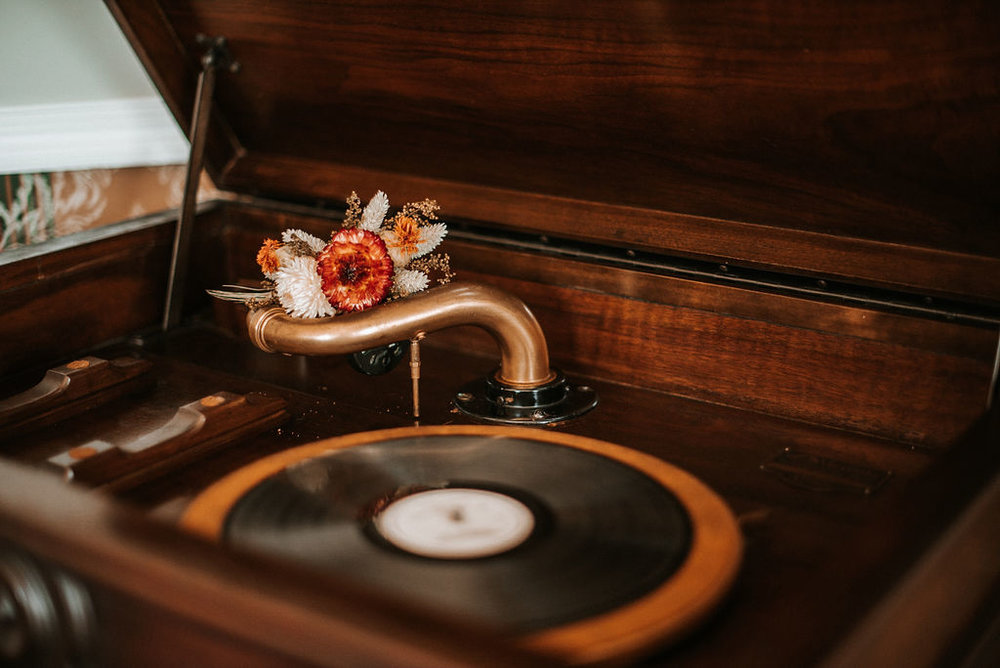 Detail Shot of Flowers and Record Player at Khimaira Farm