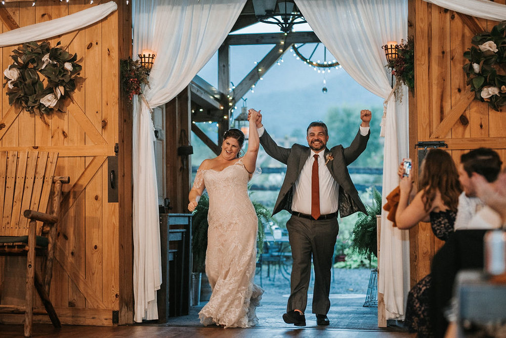 bride and groom enter the reception at Khimaira Farm