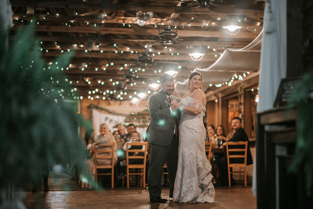 bride and groom having first dance at Khimaira Farm