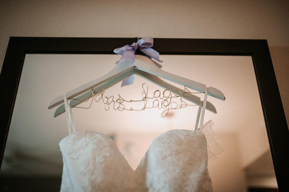 detail shot of bride's wedding hanger at kimble farm