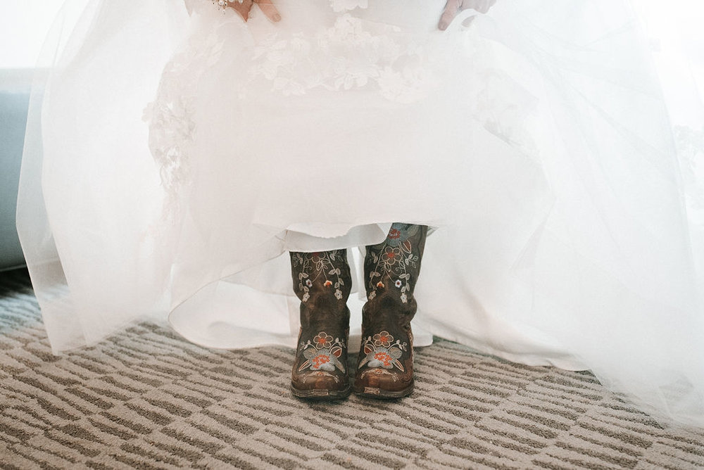 bride's cowgirl boots under wedding dress at kimble farm