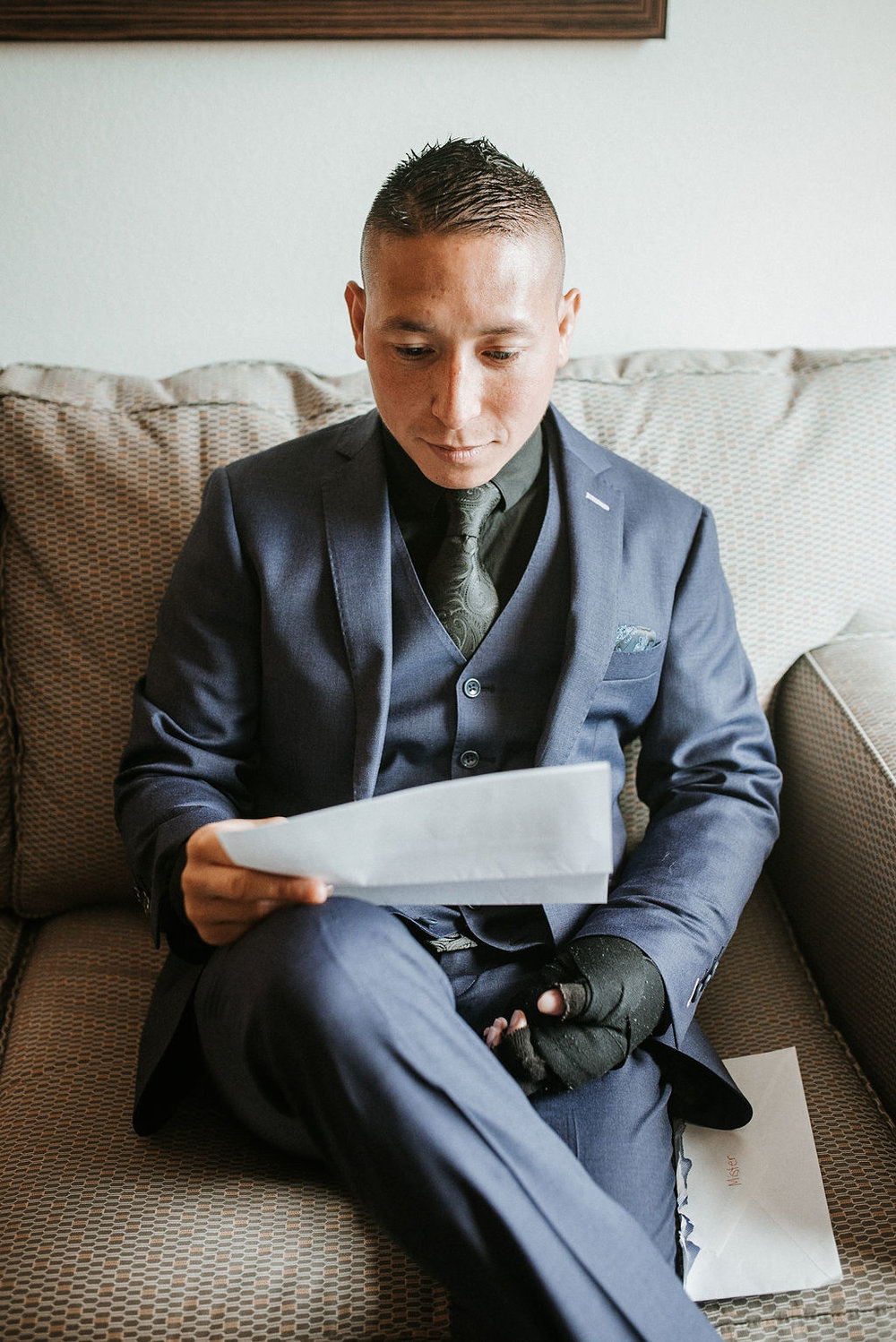 groom reading letter from bride at kimble farm