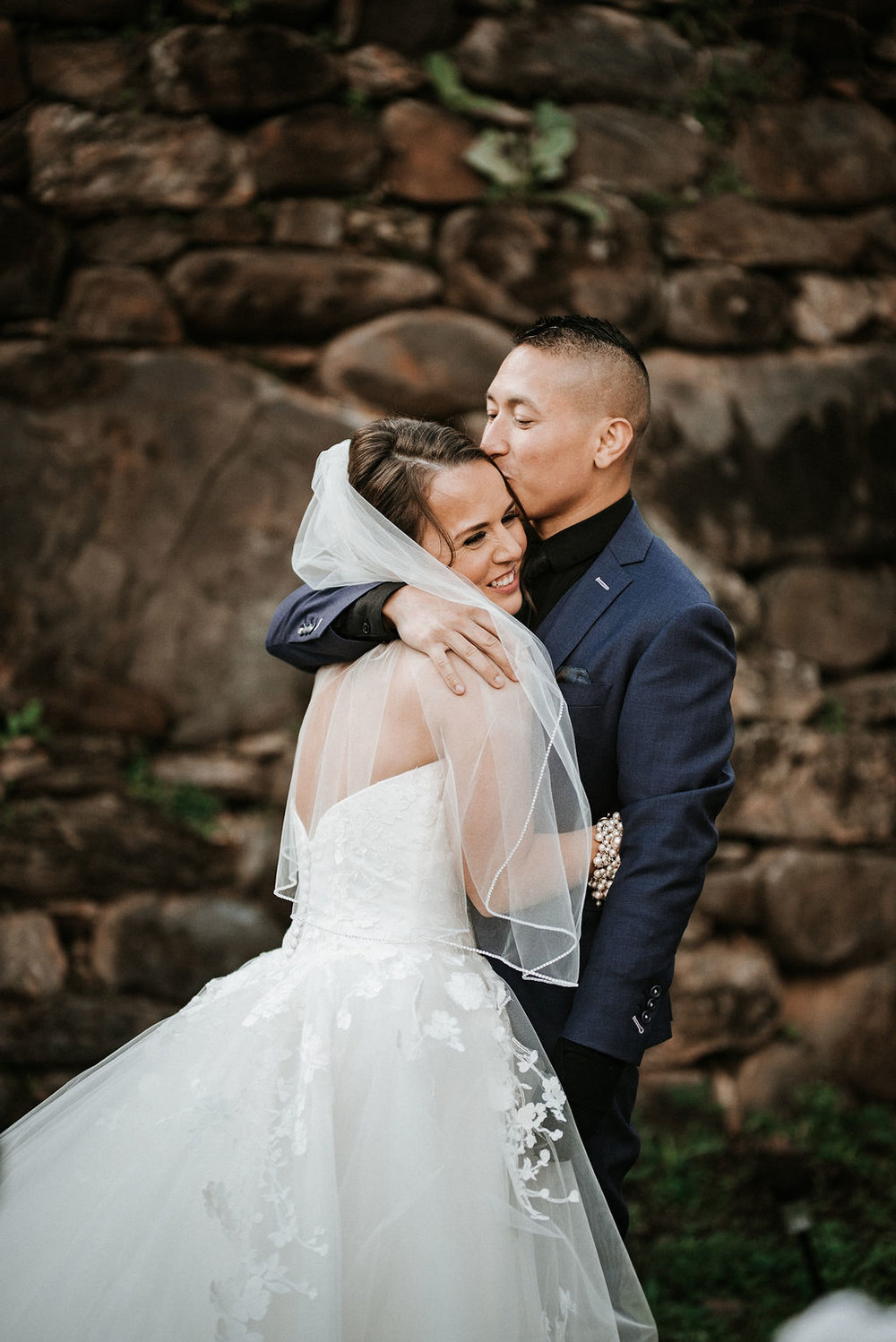 groom embracing bride after first look at kimble farm