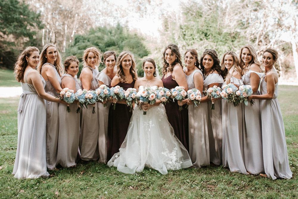 bride and bridesmaids smiling and posing at kimble farm