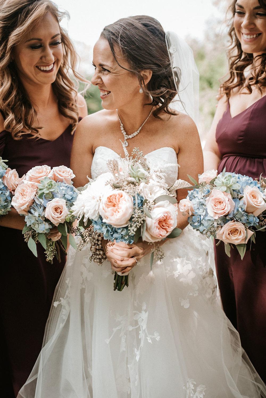 bride and bridesmaids smiling at kimble farm