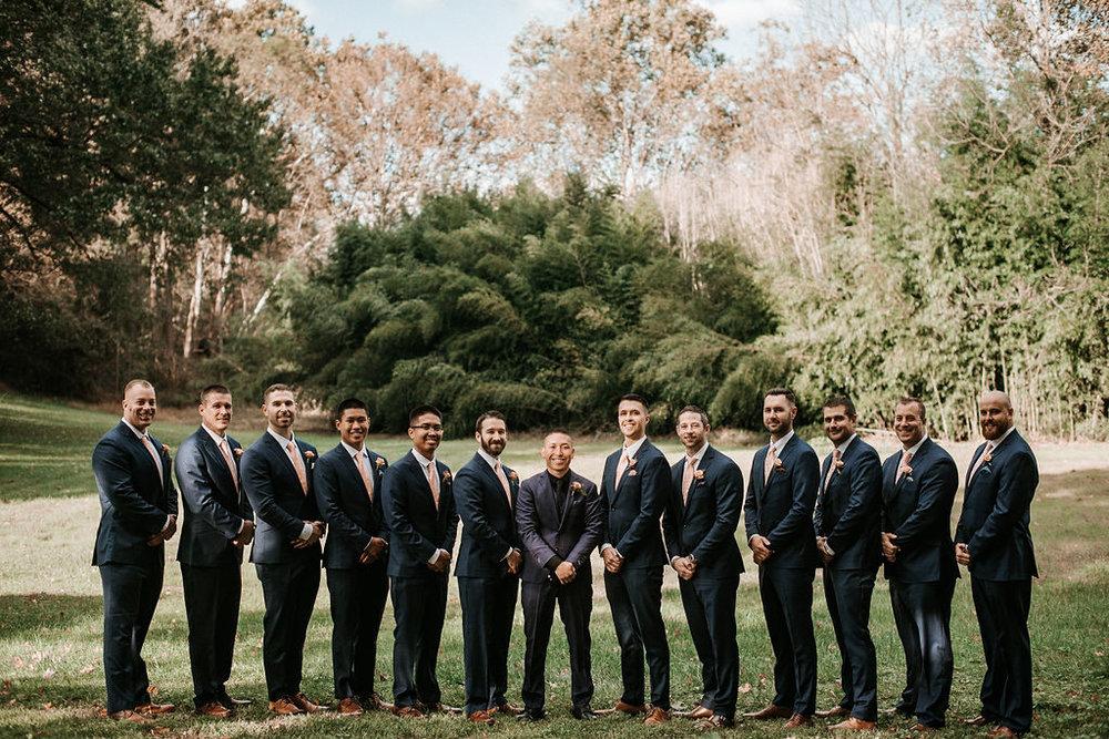 groom and groomsmen smiling and posing at kimble farm