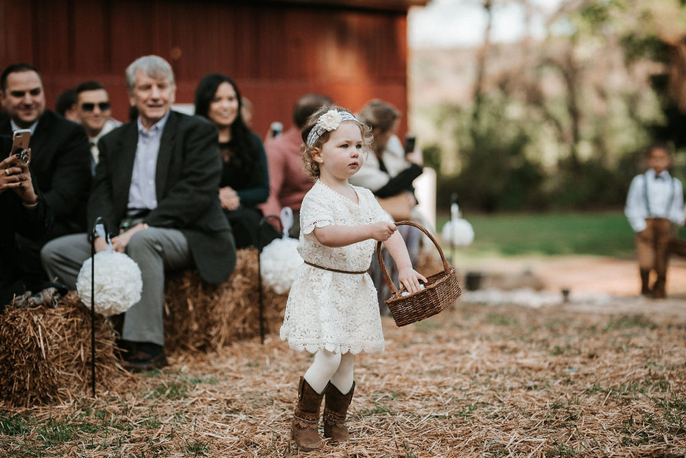 flower girl and ring bearer walking up the aisle at kimble farm