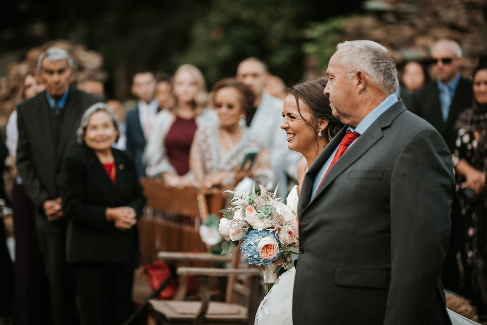 bride and father of the bride walking up the aisle at kimble farm