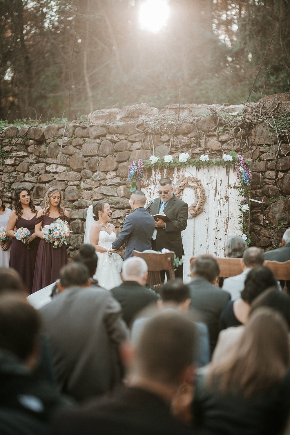 bride and groom holding hands at the alter at kimble farm