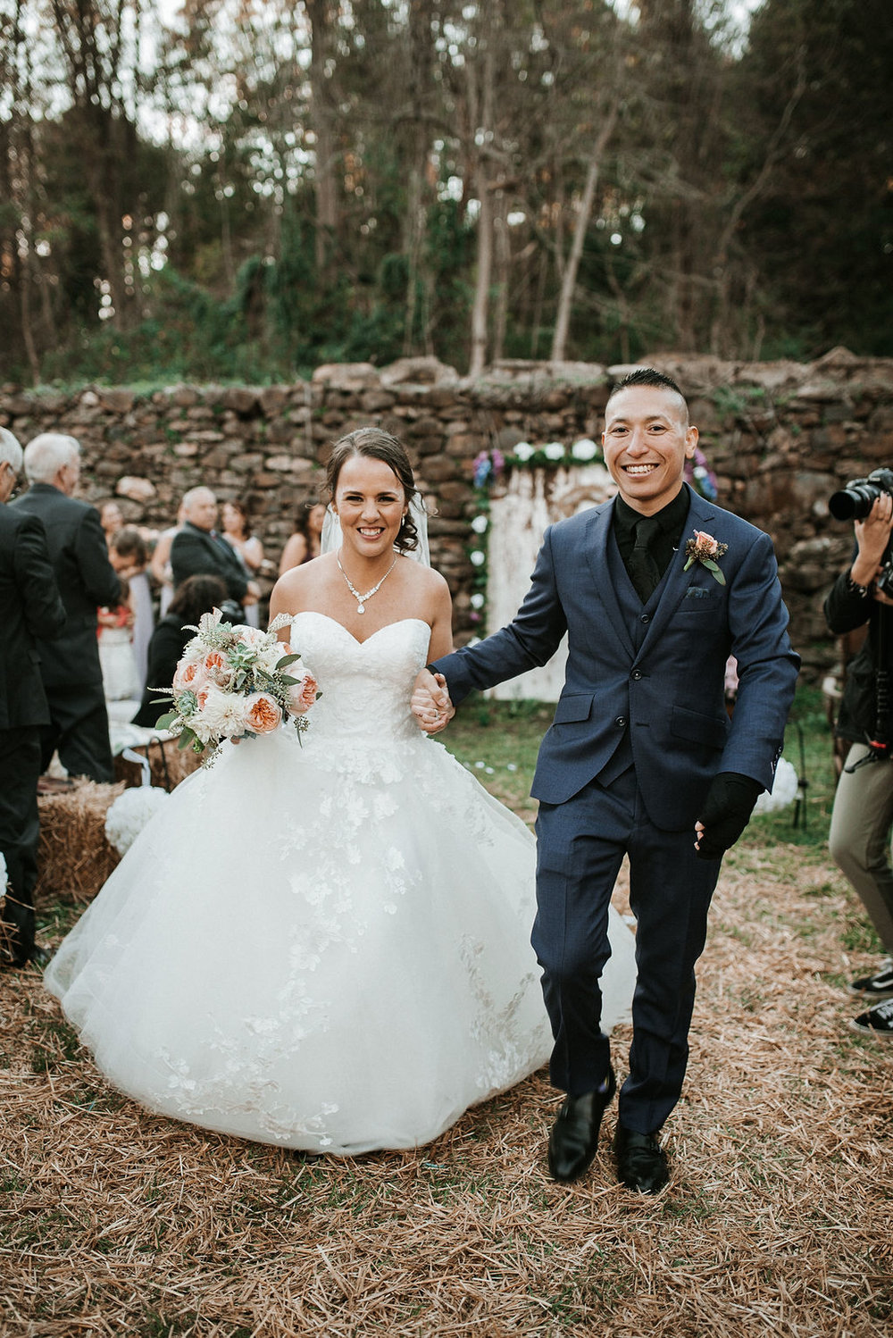 bride and groom holding hands at kimble farm
