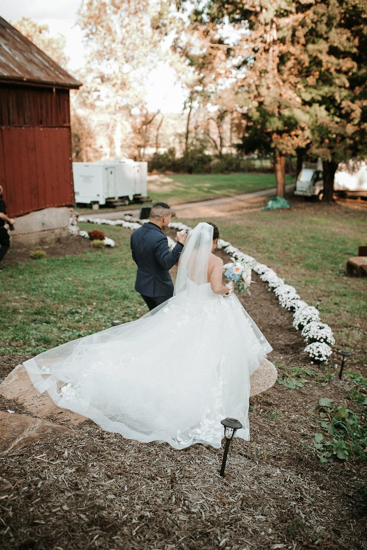 bride and groom walking up the aisle at kimble farm