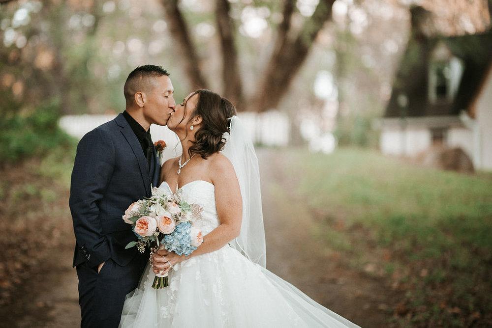 bride and groom kissing at kimble farm