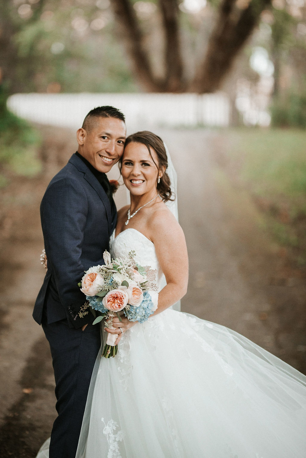 bride and groom smiling and posing at kimble farm