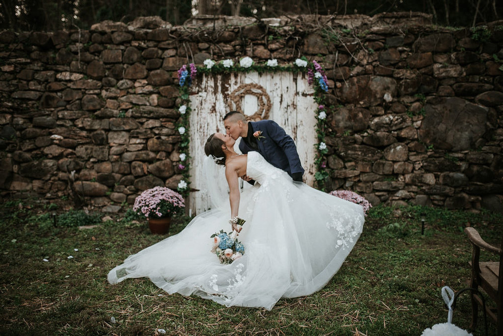 bride and groom doing a dip at ceremony site at kimble farm