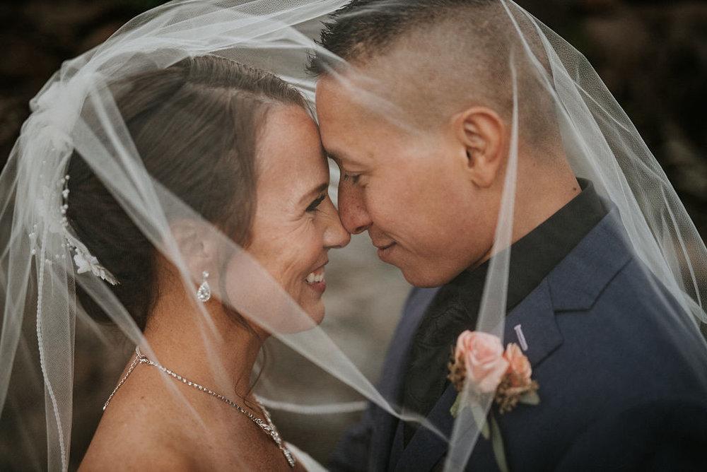 bride and groom under veil at kimble farm