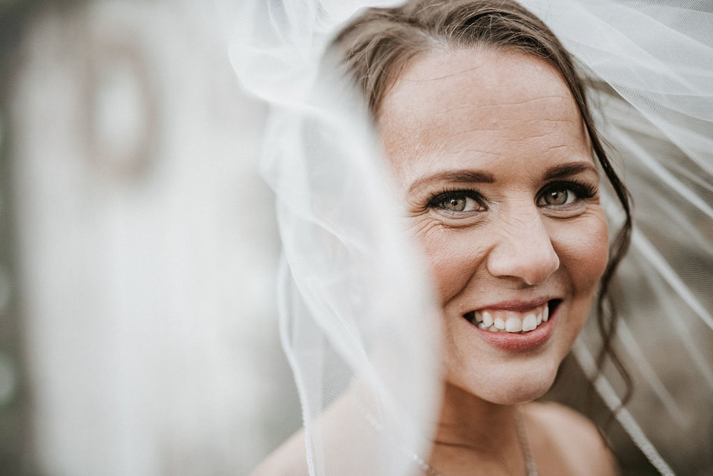 portrait of bride under veil at kimble farm