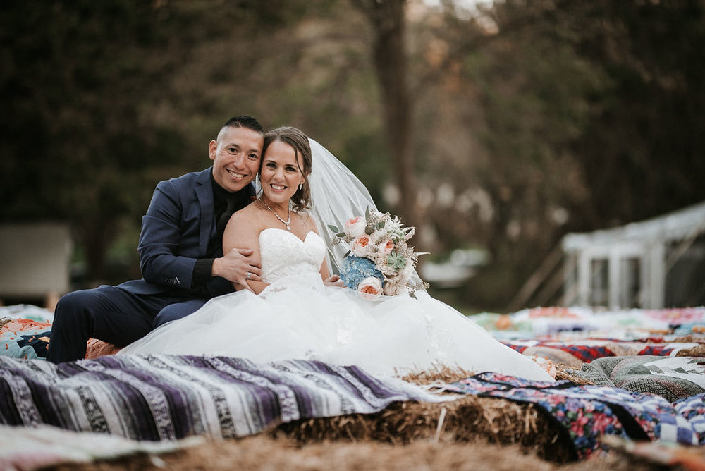 bride and groom smiling at kimble farm