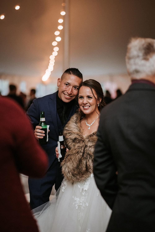 bride and groom smiling at reception at kimble farm