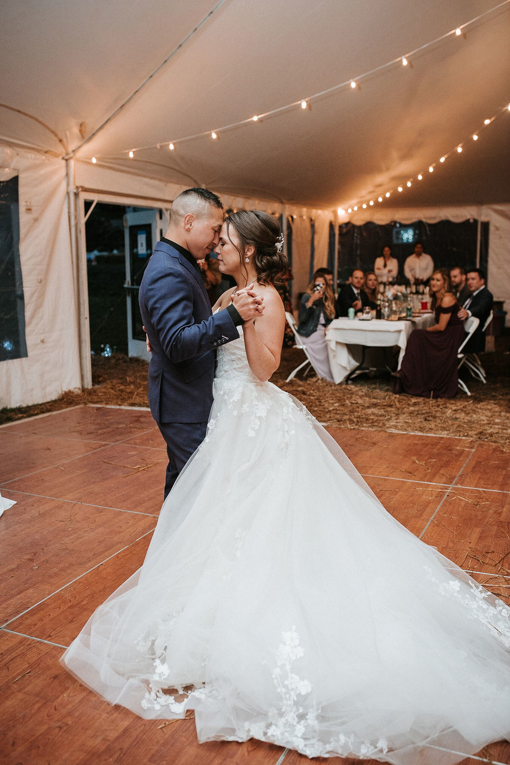bride and groom having first dance at kimble farm