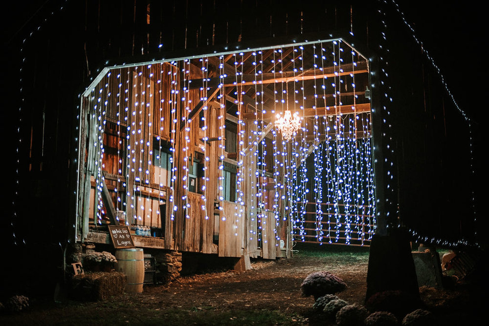 barn decorated with lights at kimble farm