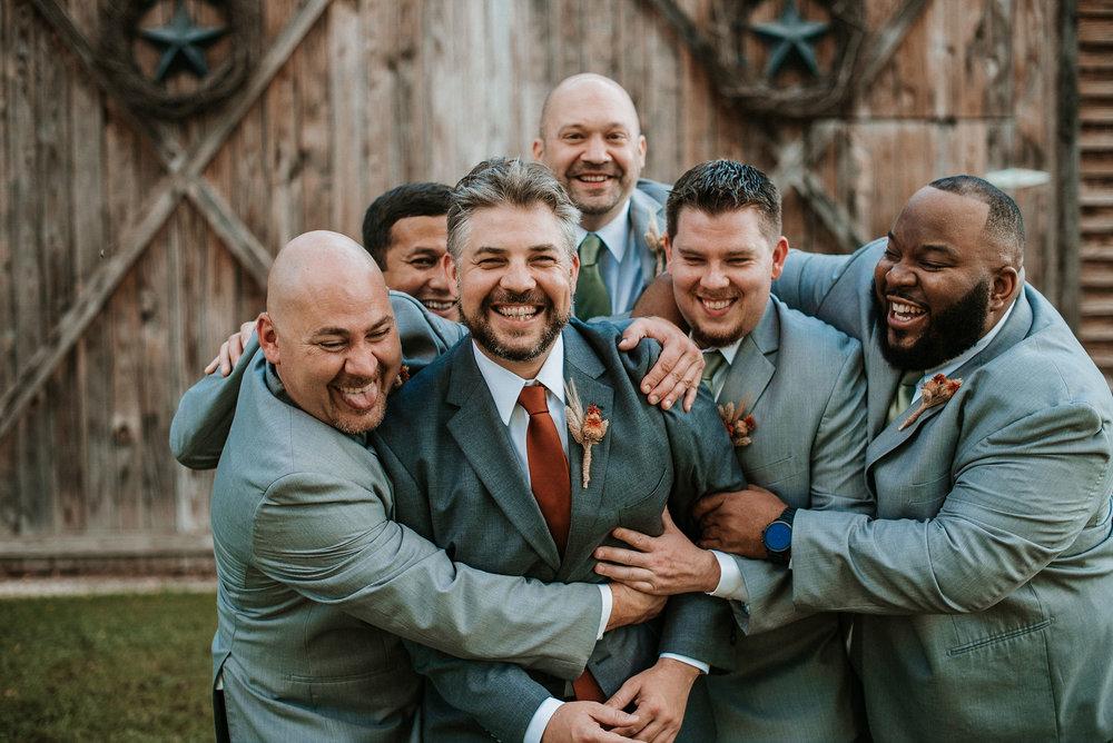 groom and groomsmen having fun at Khimaira Farm