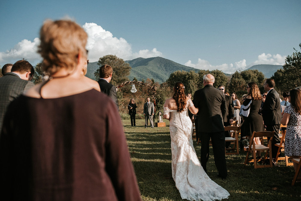 bride walking up the aisle with father of the bride at Khimaira Farm