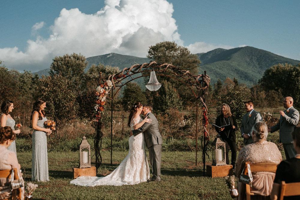 bride and groom first kiss at Khimaira farm