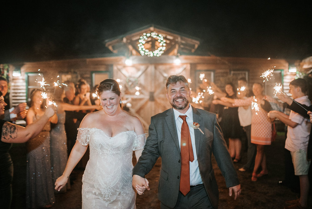 bride and groom sparkler exit at Khimaira Farm