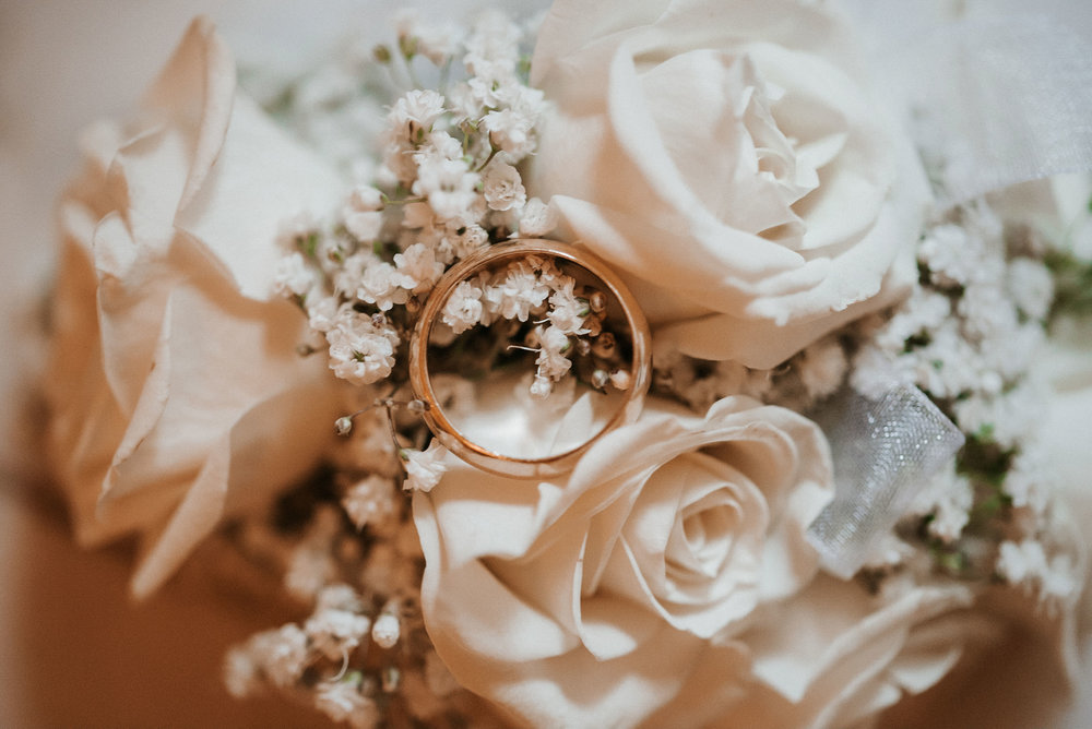 detail shot of wedding ring with flowers at St. Mark Orthodox Church