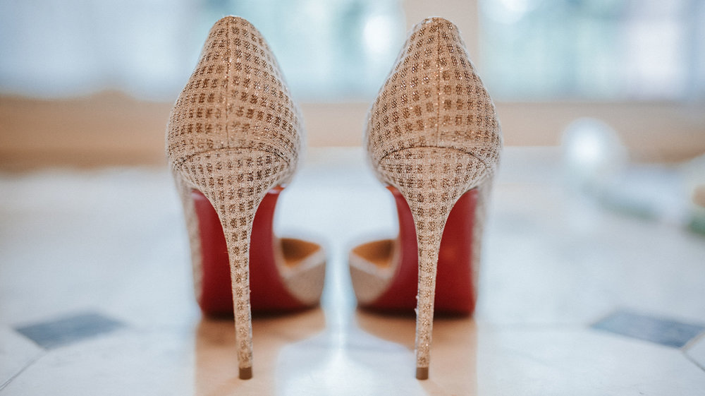 detail shot of bride's shoes at St. Mark Orthodox Church