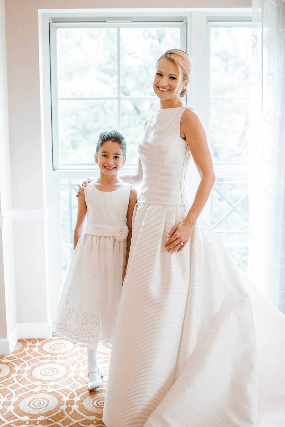 bride and junior bridesmaid smiling at St. Mark Orthodox Church