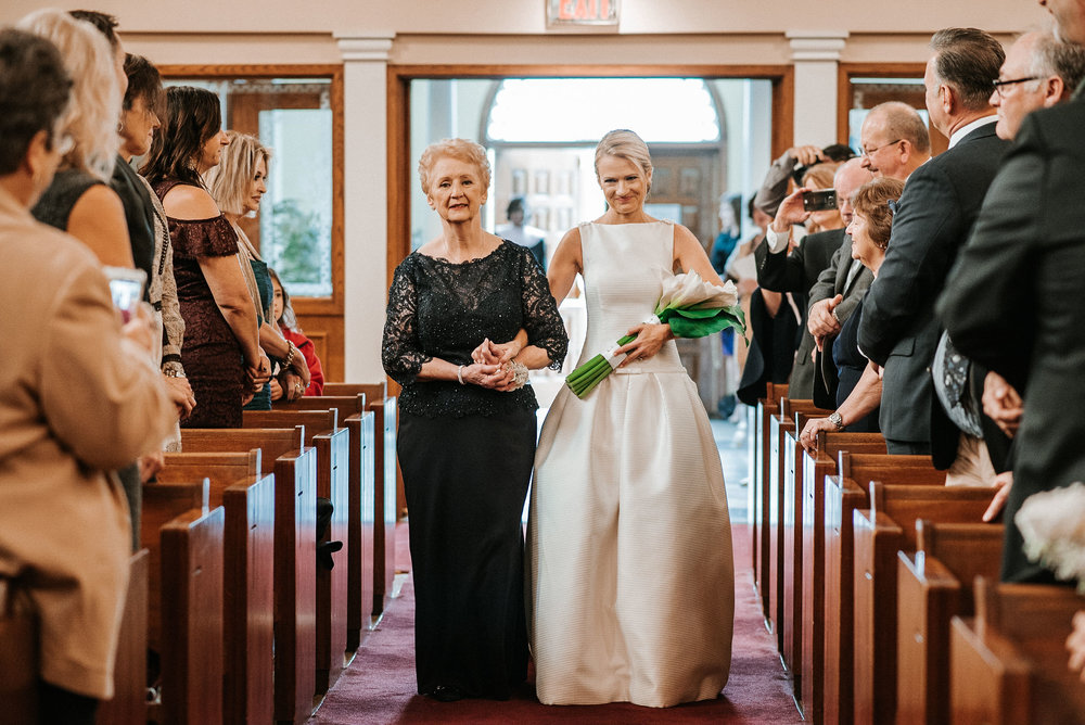 bride walking down the aisle at St. Mark Orthodox Church