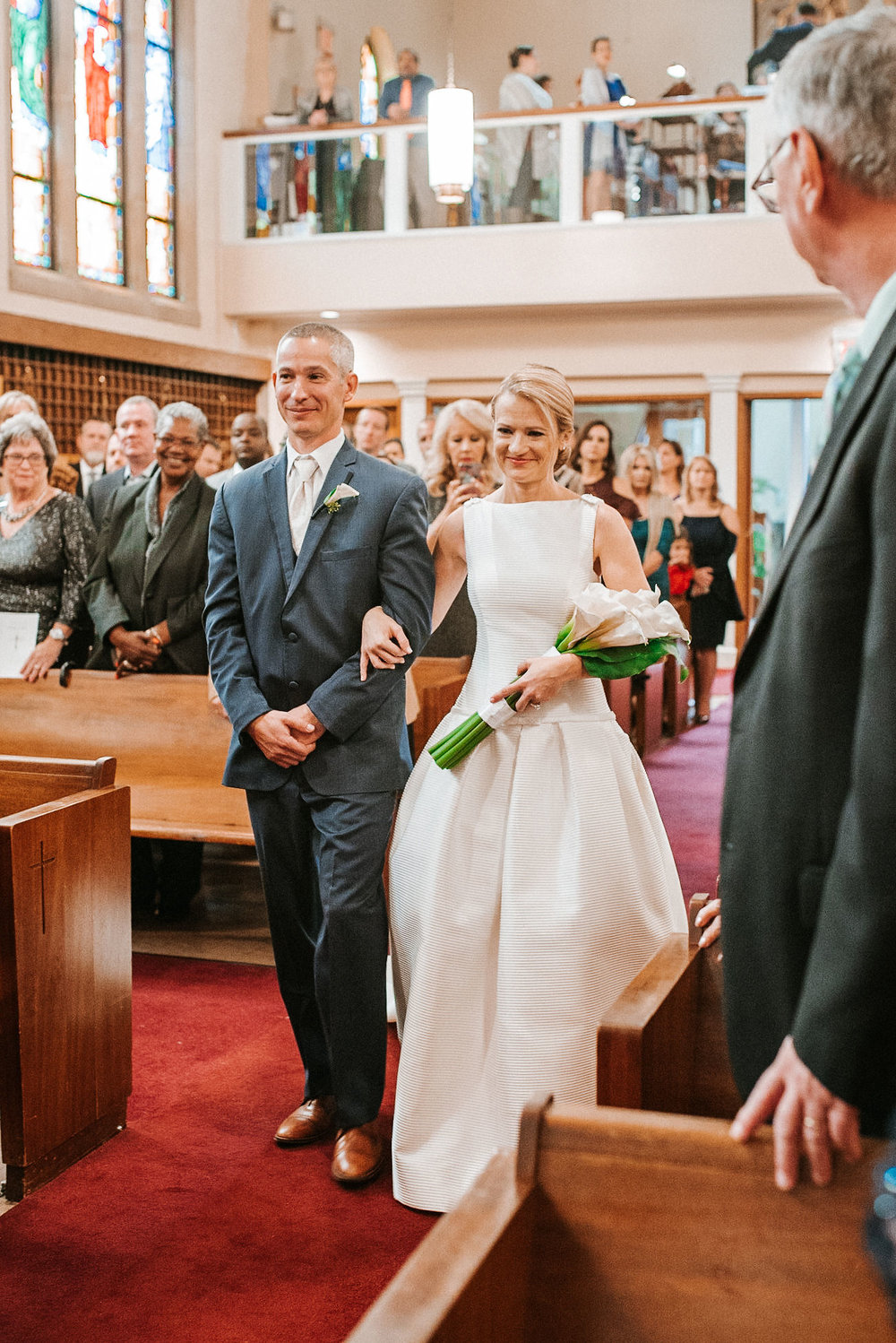 groom and bride walking up the aisle at St. Mark Orthodox Church
