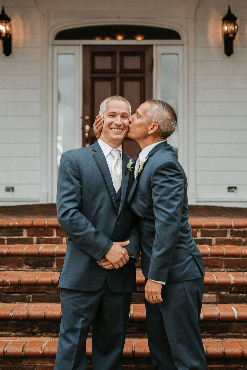 groom and best man posing at St. Mark Orthodox Church