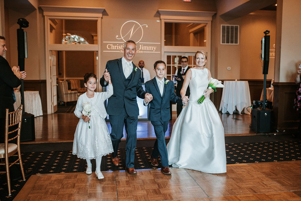 family shot of bride and groom and kids at St. Mark Orthodox Church