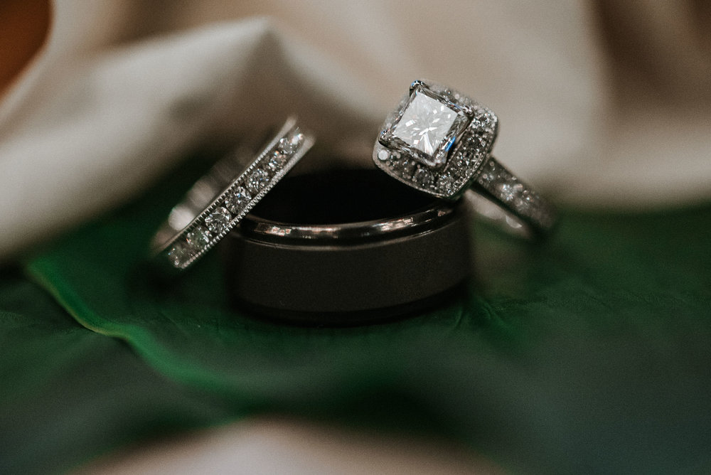 detail shot of bride and groom's wedding rings at St. Mark Orthodox Church