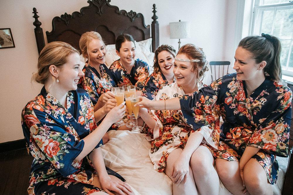 bride and her bridesmaids drinking at Braehead Manor