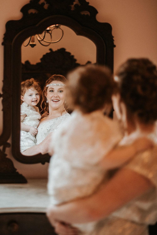 bride holding daughter at Braehead Manor
