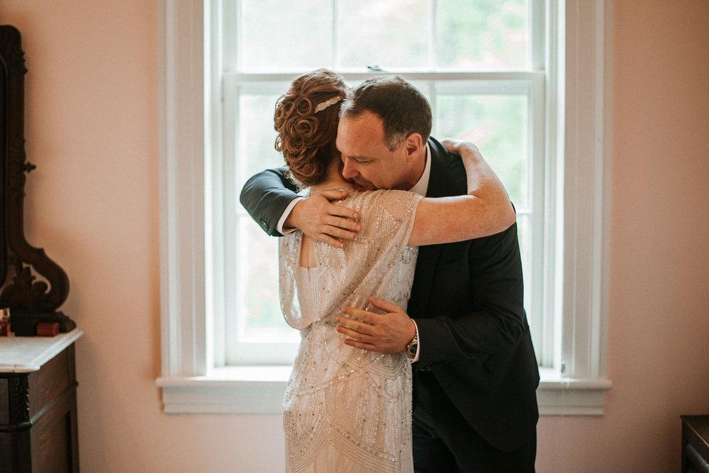 bride and father of the bride hug at Braehead Manor