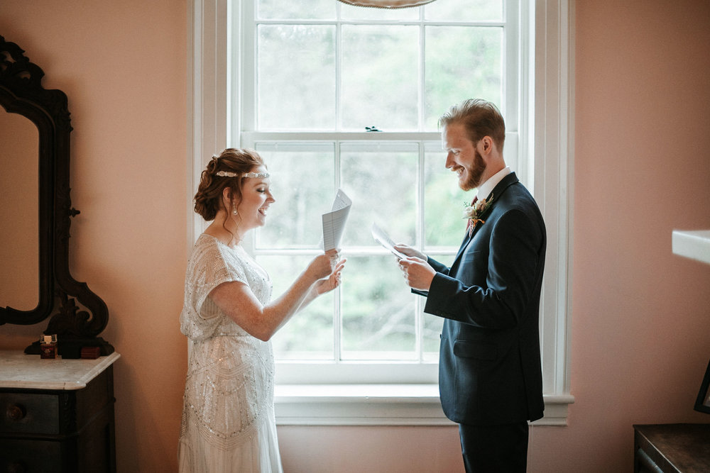 bride and groom read letters to each other at Braehead Manor