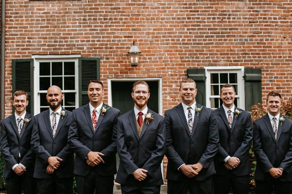 groom and groomsmen posing at Braehead Manor