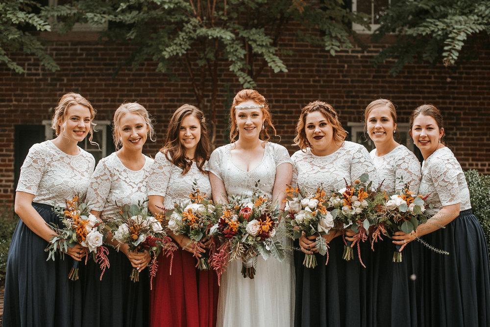 bride and bridesmaids posing at Braehead Manor