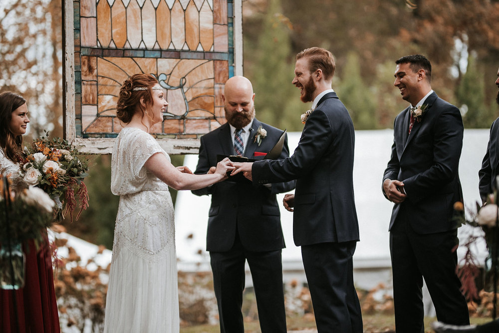 bride and groom exchanging rings at Braehead Manor