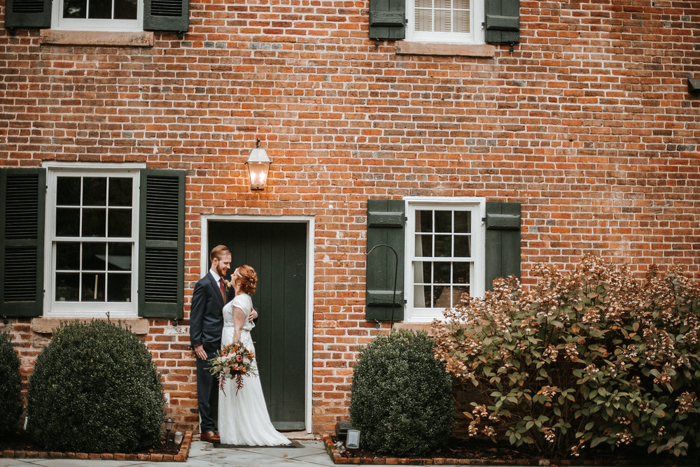 bride and groom posing at Braehead Manor