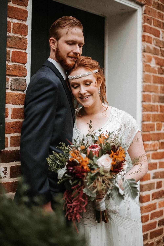bride and groom embracing at Braehead Manor