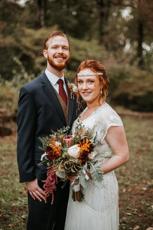 bride and groom smiling at Braehead Manor